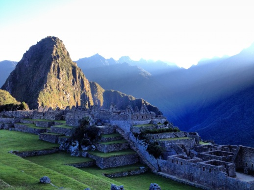 sun rising over Machu Picchu