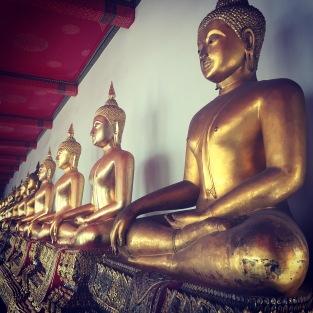 Buddhas lining the temple Wat Pho in Bangkok