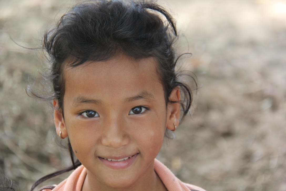 little girl on an island off of Kratie in Cambodia
