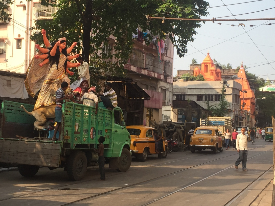 a truck moving Durga statues to various locations throughout the city