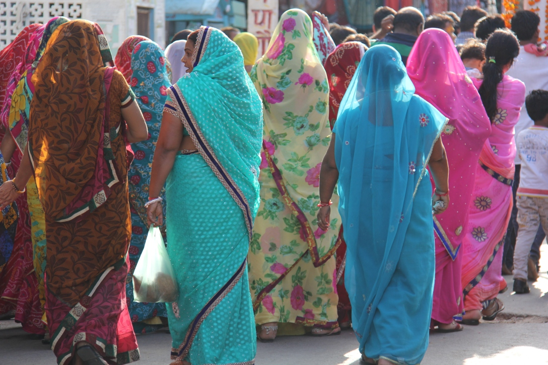 group of women walking through the bazaar in Pushkar